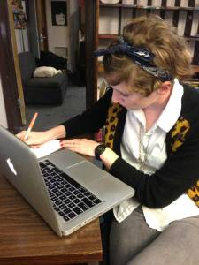 Kathryn Varn transcribes notes for a story at the office of The Alligator. Varn is the police beat reporter this semester.