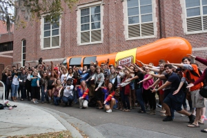 Students in Multimedia Writing and I gathered at the Wienermobile with Hotdoggers Holly Nelson and Lisa Rosenblum for a group photo after class. The Wienermobile was visiting the University of Florida to recruit students to apply to be on the next Hotdogger team. Photos by Casey Kochey
