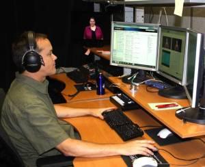 Joe Nicholson checks the audio levels during recordin