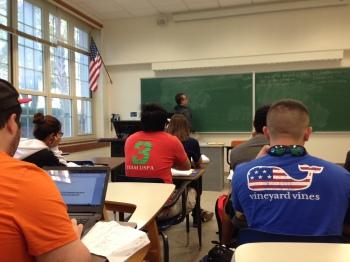 teacher at chalkboard