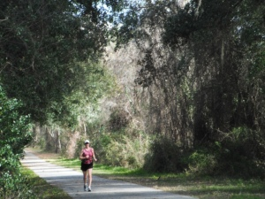 When running the Gainesville-Hawthorne Trail, I wear a hat and sunscreen and take a drink.