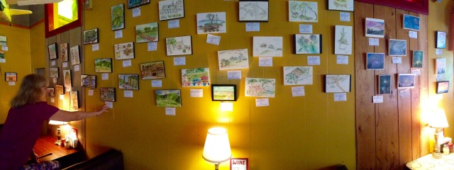 artwork on display at Satchel's Pizza