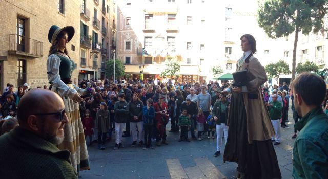 Petit Gegants Eulalia and Josep Oriol perform outside Santa Maria del Pi